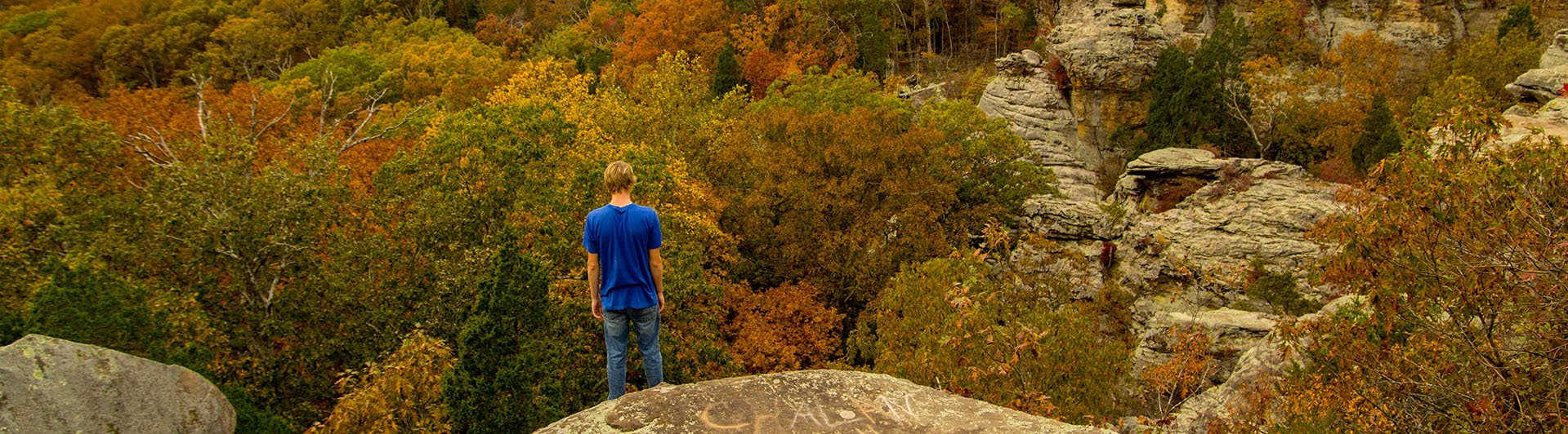 Young man looking over Garden of the Gods in the Shawnee National Forest