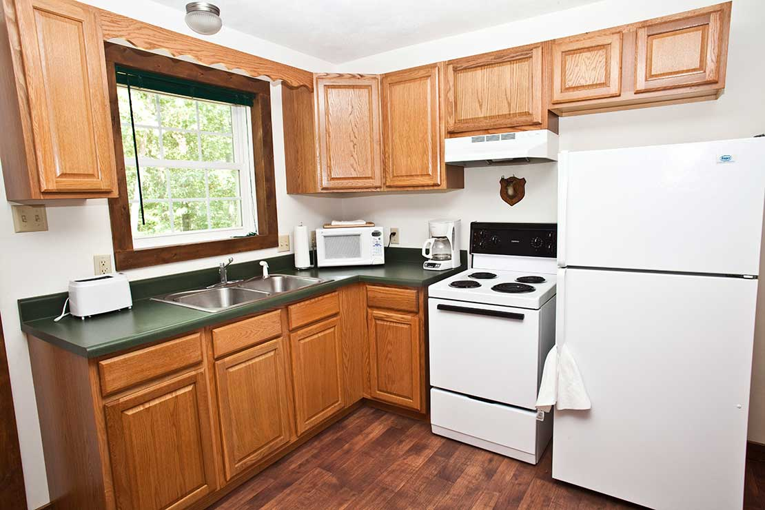 Outdoorsman cabin's fully furnished kitchen